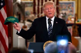 """President Donald Trump speaks during a """"Made in America Product Showcase"""" at the White House, July 23, 2018."""