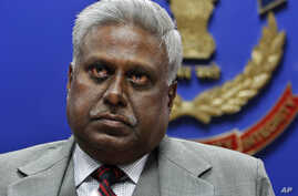 FILE - India's newly elected Central Bureau of Investigation (CBI) Director Ranjit Sinha addresses a press conference at its headquarters in New Delhi, India.
