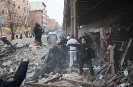 Police respond to the scene of an explosion and building collapse in the East Harlem neighborhood of New York, March 12, 2014.