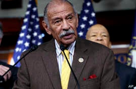 FILE - Rep. John Conyers, D-Mich., flanked by other top Democrats, speaks at a news conference on Capitol Hill in Washington.