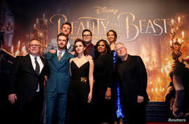 """Director Bill Condon and composer Alan Menken pose with cast members Dan Stevens, Luke Evans, Emma Watson, Josh Gad, Audra McDonald and Gugu Mbatha-Raw at the premiere of """"Beauty and the Beast"""" in Los Angeles, March 2, 2017."""