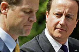 Britain's new PM David Cameron, (R) and Deputy PM Nick Clegg, host a joint news conference in the gardens of 10 Downing Street in London, 12 May 2010