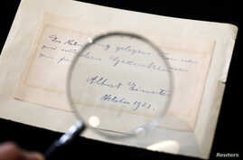 A note written by Albert Einstein to Italian chemistry student Elisabetta Piccini in Florence, Italy, in 1921 is seen before it is sold at an auction in Jerusalem, March 6, 2018.