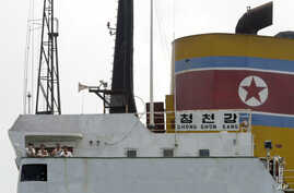 North Korean sailors stand on the deck of the North Korean-flagged cargo ship Chong Chon Gang in Sherman Bay near Colon City, Panama, February 12, 2014.
