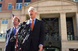 FILE - Virginia Attorney General Mark Herring, right, accompanied by Virginia Solicitor General Stuart Raphael, speaks outside the federal courthouse in Alexandria, Va., Friday, Feb. 10, 2017, following a hearing on President Donald Trump's travel ba