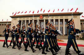 FILE - Members of the Chinese military march as President Donald Trump and Chinese President Xi Jinping participate in a welcome ceremony at the Great Hall of the People, Nov. 9, 2017, in Beijing, China.