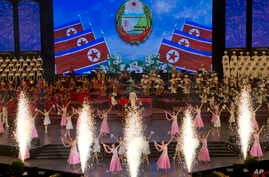 Performers dance during an evening gala held on the eve of the 70th anniversary of North Korea's founding day in Pyongyang, North Korea, Sept. 8, 2018. North Korea will be staging a major military parade, huge rallies and reviving its iconic mass gam