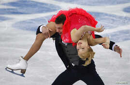 Russia's Ekaterina Bobrova (top) and Dmitri Soloviev compete during the figure skating ice dance short dance program at the Sochi 2014 Winter Olympics Feb. 16, 2014.