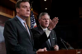 Sen. Mark Warner, D-Va., left, the vice chairman of the Senate Select Committee on Intelligence, and Chairman Richard Burr, R-N.C., right, speak to reporters about their panel's investigation of Russian interference in the 2016 election, on Capitol H