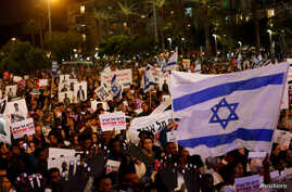 FILE - People take part in a protest against the Israeli government's plan to deport African migrants, in Tel Aviv, Israel March 24, 2018.