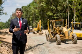 Stephen Bell, president and CEO of the Arkadelphia Area Chamber of Commerce, talks about a new railroad spur that is being built to support the needs of what he hopes will be a new paper mill, one of several Chinese-backed deals Arkansas has landed i