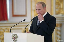 Russia's President Vladimir Putin delivers a speech at the Kremlin in Moscow, Russia, May 28, 2015.