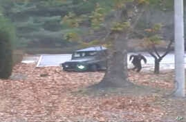 This image made from Nov. 13, 2017, surveillance video released by the U.N. Command shows a North Korean soldier running from a jeep; he was later shot by North Korean soldiers. The North Korean soldier was shot at least five times as he limped acros