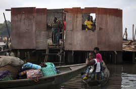 People stand inside a roofless stilt house as the government begins the demolition of illegal homes in Lagos.