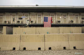 A U.S. flag hangs off of a housing unit inside of Bagram Air Field in the Parwan province of Afghanistan, Jan. 2, 2015.
