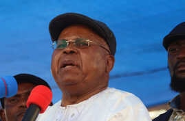 FILE - Congo opposition leader Etienne Tshisekedi speaks during a political rally in Kinshasa, Congo, July 31, 2016.