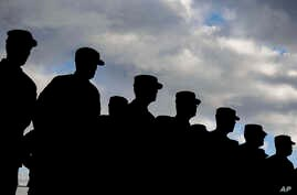 FILE - US soldiers  stand in formation during a military ceremony at the Storck barracks in Illesheim, Germany.