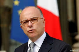 FILE - French Interior Minister Bernard Cazeneuve speaks about fires that hit the south of France, in the Elysee Palace courtyard at the end of a defense council in Paris, France, August 11, 2016.