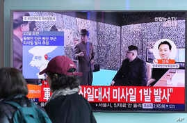 Visitors walk by a TV screen showing a news program with a file footage of North Korean leader Kim Jong Un at the Seoul Train Station in Seoul, South Korea, March 22, 2017. North Korea's latest missile launch ended in failure Wednesday. The Korean le
