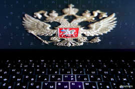The coat of arms of Russia is reflected in a laptop screen in this picture illustration taken Feb. 12, 2019.