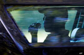President Barack Obama is seated in the presidential vehicle as his motorcade leaves after playing a round of golf at Farm Neck Golf Course in Oak Bluffs, Massachusetts, on Martha's Vineyard, Aug. 18, 2016.