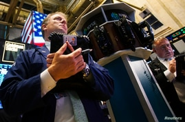 Traders work on the floor of the New York Stock Exchange August 1, 2013.