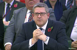 FILE - Head of M15 Andrew Parker is seen attending an Intelligence and Security Committee hearing at Parliament, in this still image taken from video in London, Nov. 7, 2013.
