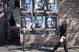 "Posters of French presidential election candidates as part of a campaign of ""Solidarite Sida"" in Paris, France, April 19, 2017."