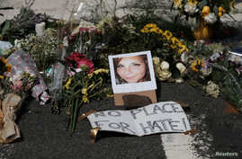 Flowers and a photo of car ramming victim Heather Heyer lie at a makeshift memoriall in Charlottesville, Virginia, Aug. 13, 2017.