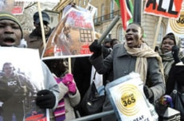 Protesters calling on the British Government intervention to prevent war in Sudan are pictured opposite 10 Downing St. in London, 09 Jan 2010