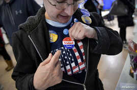 "A voter puts on an ""I voted"" sticker during the U.S. presidential election in Philadelphia, Pennsylvania, Nov. 8, 2016."