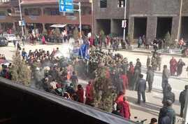 This citizen journalist image shows crowds surrounding Dorjee Rinchen, a Tibetan man who self-immolated in Labrang, China, October 23, 2012.