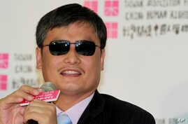 Chinese activist Chen Guangcheng listens to a reporter's question during a press conference at the Taiwan Association for China Human Rights building in Taipei, Taiwan, June 24, 2013.