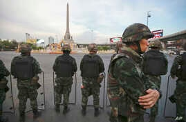 FILE - Thai soldiers guard an area to prevent an anti-coup demonstration at Victory Monument in Bangkok, Thailand.