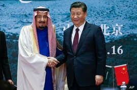 Saudi King Salman (left) and Chinese President Xi Jinping shake hands as they attend the Road to the Arab Republic - the closing ceremony of the artifacts unearthed in Saudi Arabia at China National Museum in Beijing, March 16, 2017.