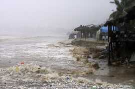 Waves flood a beach in Acapulco, Mexico, Sept. 15, 2013.
