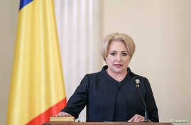 Romanian Prime Minister Viorica Dancila is sworn during a ceremony at the Cotroceni Presidential Palace in Bucharest, Romania, Jan. 29, 2018.