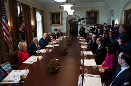 President Donald Trump, third from left, speaks during a bicameral meeting with lawmakers working on the tax cuts in the Cabinet Meeting Room of the White House in Washington, Wednesday, Dec. 13, 2017