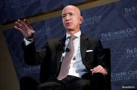 "Jeff Bezos, president and CEO of Amazon and owner of The Washington Post, speaks at the Economic Club of Washington's ""Milestone Celebration Dinner"" in Washington, Sept. 13, 2018."