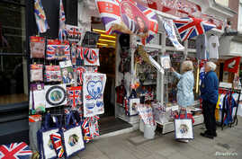 People browse for Royal Wedding souvenirs ahead of Prince Harry and Meghan Markle's wedding in Windsor, Britain, May 16, 2018.