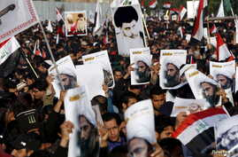 Supporters of Shi'ite cleric Moqtada al-Sadr protest against the execution of Shi'ite Muslim cleric Nimr al-Nimr in Saudi Arabia, during a demonstration in Baghdad Jan. 4, 2016.
