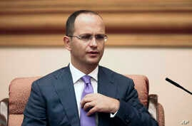 FILE - Albania's Foreign Minister Ditmir Bushati speaks during a meeting with China's State Councilor Yang Jiechi in Beijing, Aug. 26, 2016.