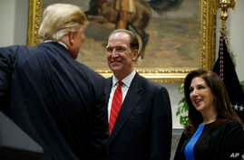 President Donald Trump greets David Malpass, under secretary of the Treasury for international affairs, and his wife Adele, after announcing his nomination to head the World Bank, during an event in the Rosevelt Room of the White House, Feb. 6, 2019,