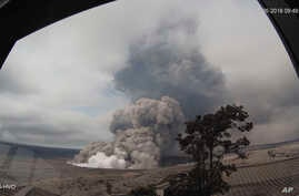 This May 26, 2018, remote image from the U.S. Geological Survey Hawaiian Volcano Observatory Tower shows explosive episodes at Halema'uma'u overlook vent wide angle at Kilauea's volcano's summit, which scientists say are caused by magma withdrawing f