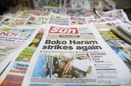 A newspaper's front-page headline reports the abduction of women from a village in northeast Nigeria, displayed at a vendor's stand along a road in Ikoyi district in Lagos, Nigeria, June 10, 2014.