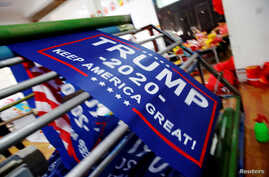 """Flags for U.S. President Donald Trump's """"Keep America Great!"""" 2020 re-election campaign are made at Jiahao flag factory in Fuyang, Anhui province, China, July 24, 2018."""