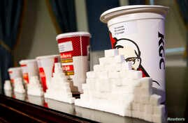 A 64-ounce drink is displayed alongside other soft drink cup sizes n New York, May 31, 2012.
