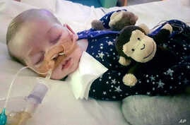 This is an undated photo of sick baby Charlie Gard provided by his family, taken at Great Ormond Street Hospital in London. A British court will assess new evidence Monday July 10, 2017, in the case of 11-month-old Charlie Gard as his mother pleaded