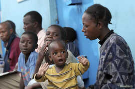 FILE - Patients queue for anti-tuberculosis drugs at the Blue house clinic, run by medical charity Medecins Sans Frontieres (MSF), in the Mathare valley slums of Kenya's capital Nairobi.