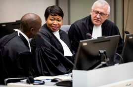 FILE - Prosecutor Fatou Bensouda (C) and Deputy Prosecutor James Stewart (R) attend the first audience with the chief of Central African Republic's soccer federation Patrice-Edouard Ngaissona at the International Criminal Court (ICC) in The Hague, th